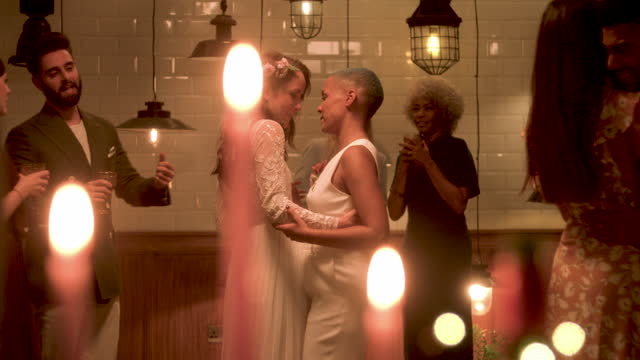 newlywed lesbian couple dancing at wedding reception - wedding stock videos & royalty-free footage