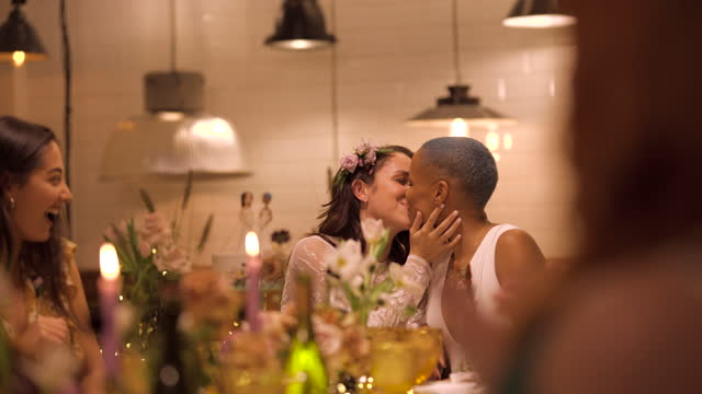 newlywed lesbian couple kissing at wedding reception - five people stock videos & royalty-free footage
