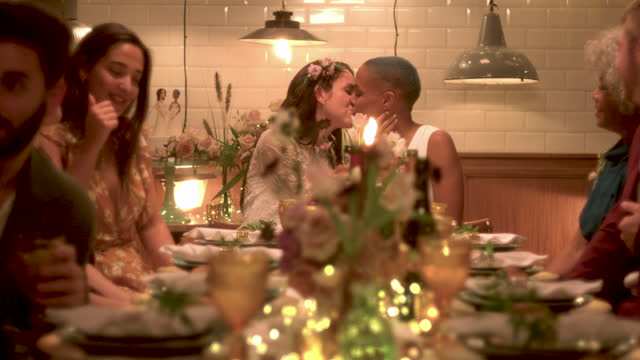 newlywed lesbian couple kissing at wedding reception - waist up stock videos & royalty-free footage