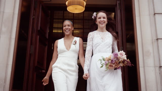 newlywed lesbian couple leaving wedding venue celebrating their marriage - politics and government stock videos & royalty-free footage