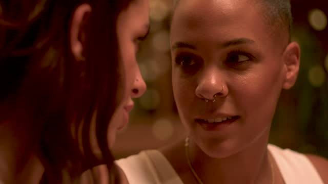 newlywed lesbian couple looking at wedding ring at reception - party social event stock videos & royalty-free footage