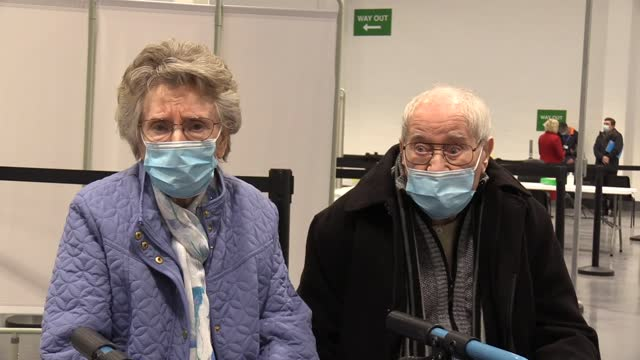 newlywed pensioners geoff and jenny holland get their jabs at the new mansfield vaccination centre, at a former wickes store in the town. - married stock videos & royalty-free footage