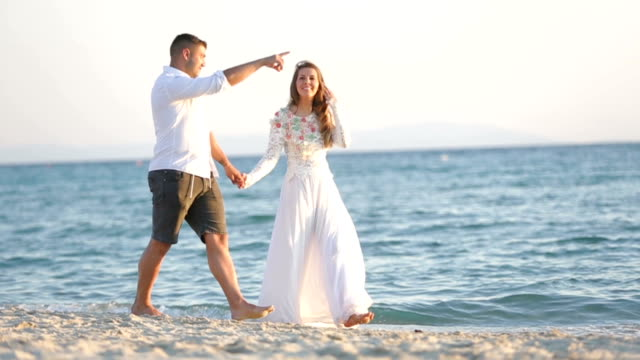 newlywed walking on the beach - just married stock videos and b-roll footage