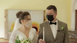 Newlyweds. Caucasian groom with bride with candle on wedding ceremony. Coronavirus covid-19