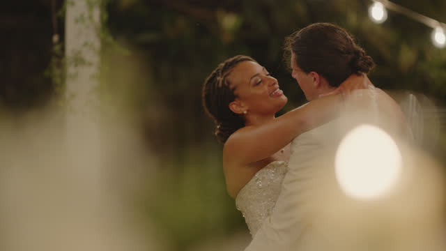 slo mo newlyweds gaze into each others eyes as they dance on their wedding night - eternity stock videos & royalty-free footage