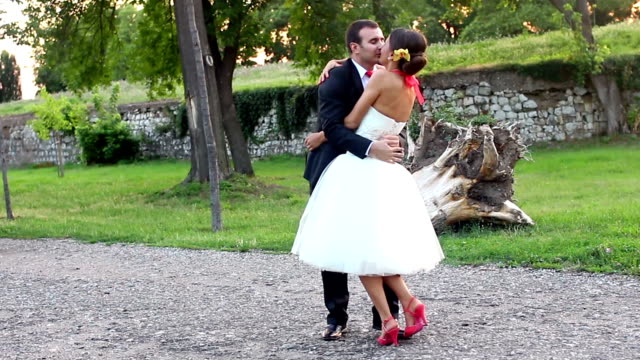 newlyweds kissing - groom stock videos and b-roll footage