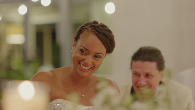 cu newlyweds laugh together while listening to a toast - speech stock videos & royalty-free footage