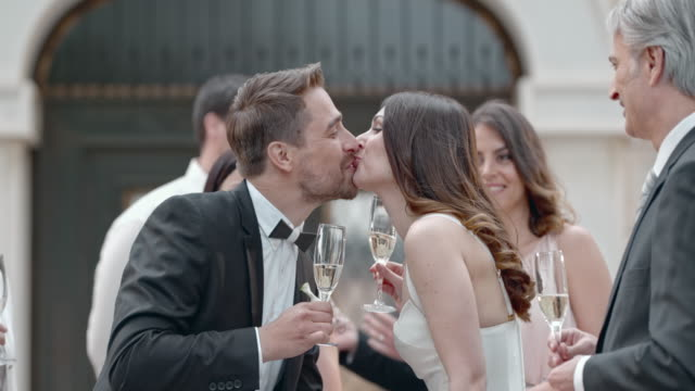 slo mo newlyweds making a toast and kissing - just married stock videos and b-roll footage