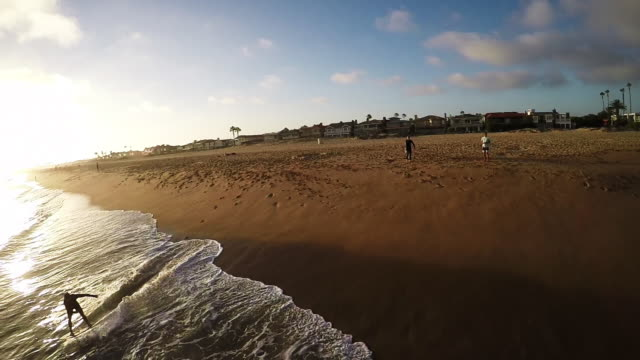 newport beach skimboarding aerial, slo-mo. - skimboard stock videos and b-roll footage