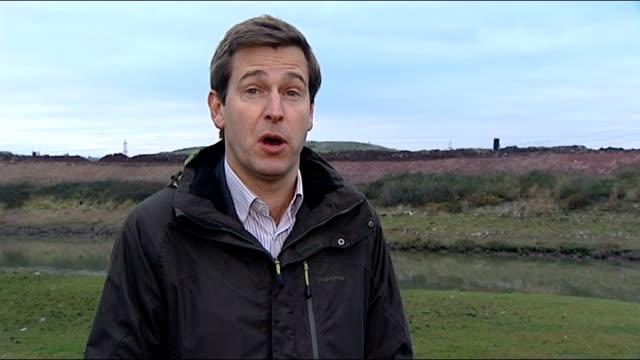 newport man searches landfill site for bitcoins worth millions reporter to camera tipper truck and digger along on landfill - bitcoin stock videos & royalty-free footage