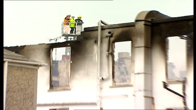 penhallow hotel fire long shot scene of crime officers on hydraulic platform assessing damage of burnt out hotel survivors getting off bus - hydraulic platform stock videos & royalty-free footage