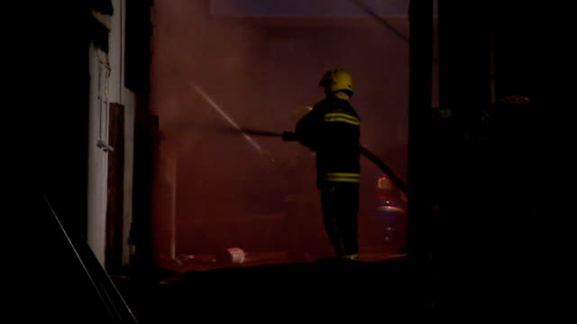 penhallow hotel fire night firefighters at work smoking remains of hotel with being sprayed by firefighter on hydraulic platform - hydraulic platform stock videos & royalty-free footage
