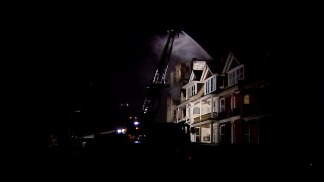 penhallow hotel fire night smoking remains of hotel with being sprayed by firefighter on hydraulic platform charred remains of section of hotel... - hydraulic platform stock videos & royalty-free footage