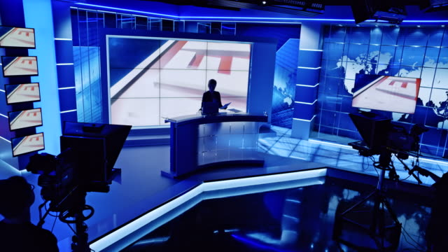 cs news anchor standing by the anchor desk with lights turned off in the studio - press conference stock videos and b-roll footage