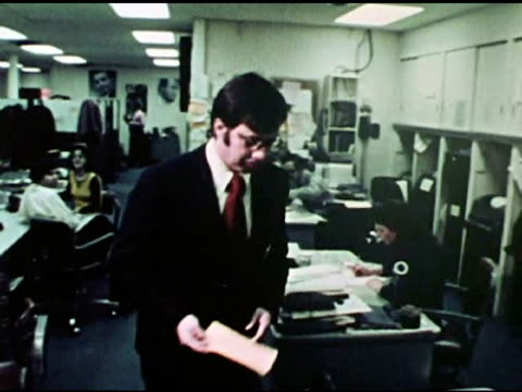 news assignment editor sending reporters out to cover a water main break / reporter bob lape checking incoming news bulletins from flash news desk /... - television show stock videos & royalty-free footage