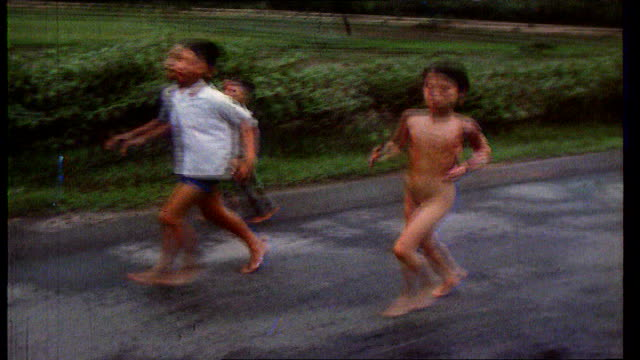 news at ten to return file / tx children running after napalming in vietnam by us troops including naked girl kim phuc - mädchen stock-videos und b-roll-filmmaterial