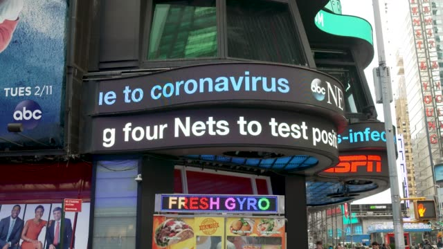 news data ticker tape, times square new york city, usa. ticker tape displays news about the outbreak of the coronavirus disease 2019 and stock market... - device screen stock videos & royalty-free footage