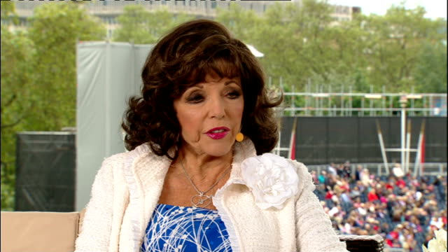 1200 1300 Joan Collins interview continued SOT St Paul's EXT Lord Coe interview with reporter Romilly Weeks SOT Marching bands and crowds in The Mall...