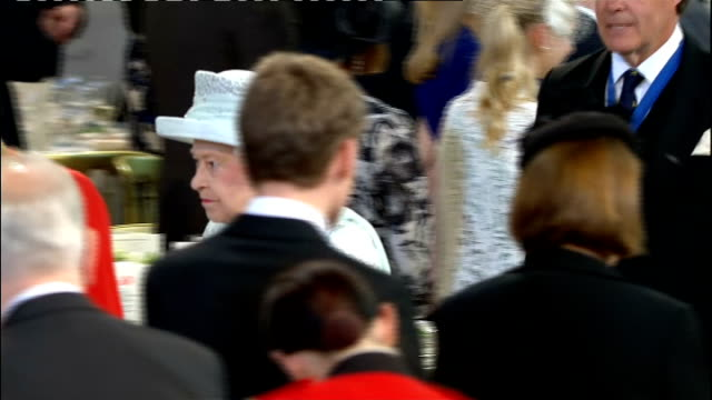 1300 1400 **Orchestral Music heard** ENGLAND London Palace of Westminster Westminster hall INT Queen Elizabeth enters Westminster Hall as fanfare and...