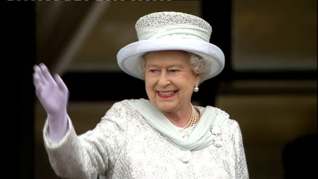 1500 1600 Queen waving from balcony of Buckingham Palace Queen's Guard and crowd giving Queen three cheers SOT Queen and Royal Family on balcony...