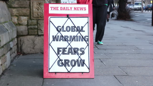 news headline board - global warming fears grow - greenhouse effect stock videos and b-roll footage
