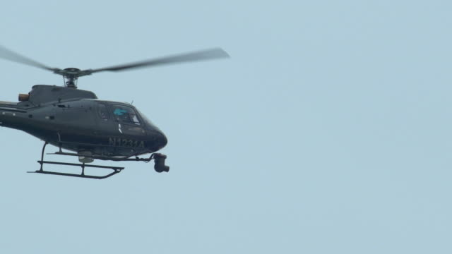 a news helicopter hovering while filming. - hovering stock videos & royalty-free footage