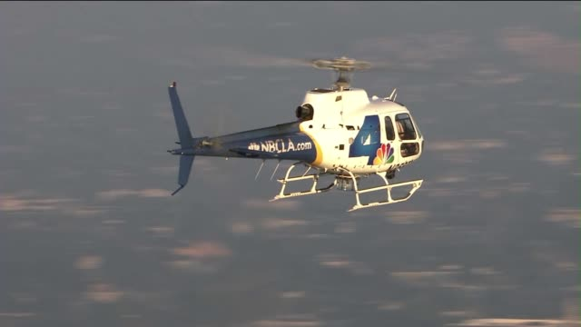 news helicopter over downtown los angeles - nbcuniversal video stock e b–roll