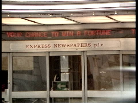 """news international dispute day 20:; england: london: fleet street: ext cms """"daily express"""" emblem pull out daily express building moving neon sign... - newspaper stock videos & royalty-free footage"""