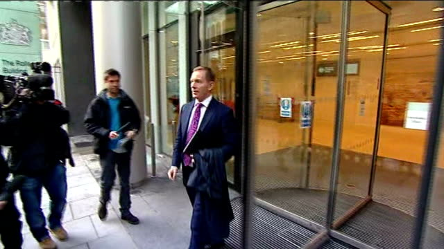 news international pay out to 18 victims of phone hacking; england: london: high court: ext chris bryant mp towards from court to speak to press as... - mp stock videos & royalty-free footage