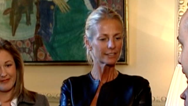 news international pay out to 18 victims of phone hacking r02110603 downing street int ulrika jonsson chatting with group of parents sot - victim stock videos & royalty-free footage