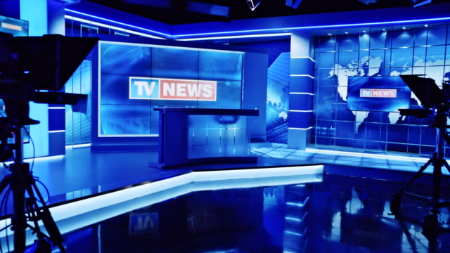 CS TV news intro displaying on the screen in an empty news studio