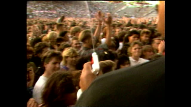 News item about some of the crowd at 1989 U2 concert suffering heat exhaustion and threat of being crushed