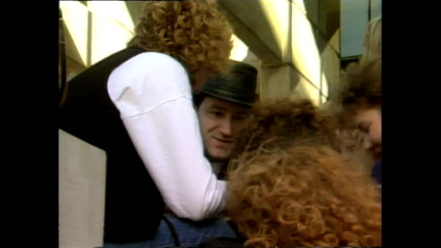 News item about U2 arriving at Christchurch Airport in 1989 and Bono signing autographs outside hotel ahead of concert at Lancaster Park