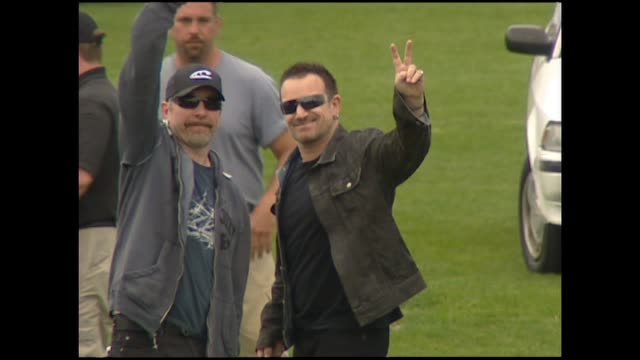 News item about U2 at soundcheck prior to concert in 2006 speaking to fans and reporter through fence