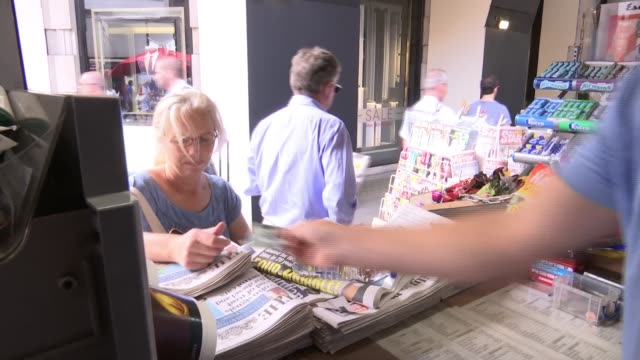 News kiosk on Sloane Square recognised as London's oldest stand ENGLAND London Sloane Square EXT Customers at newspaper kiosk Alex Bailey chatting to...