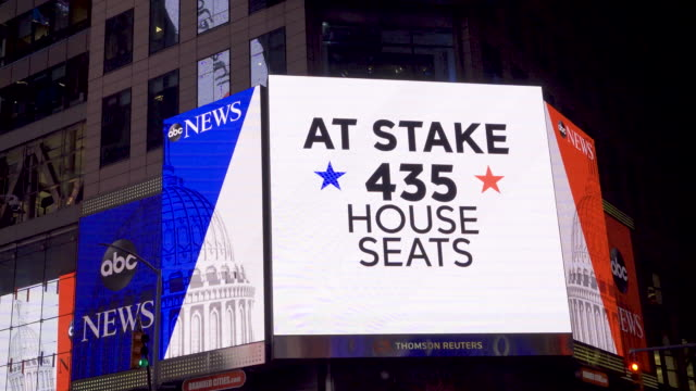 news live broadcast of the us midterm elections via giant electronic billboard screens in times square broadway seventh avenue midtown manhattan new... - midterm election stock videos & royalty-free footage