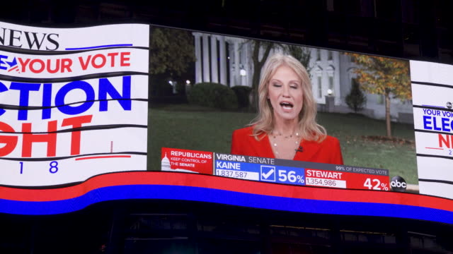 news live broadcast of the us midterm elections via giant electronic billboard screens in times square, broadway & seventh avenue, midtown manhattan,... - electronic billboard stock videos & royalty-free footage
