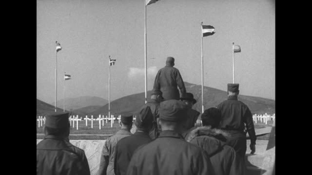 news media /arrival /Ambassador Ellis O Briggs and military officers and General Van Fleet salute after the general places a wreath beneath flags of...