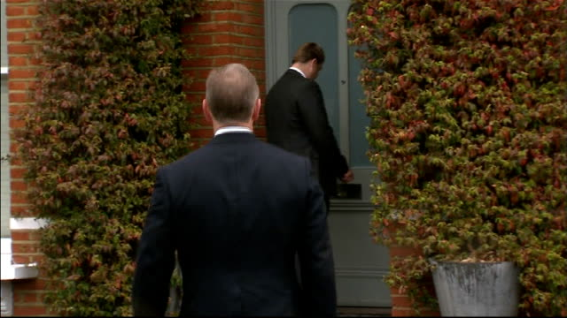 andy coulson arrested england london ext police detectives arriving at home of former news of the world editor andy coulson - andy coulson stock videos & royalty-free footage