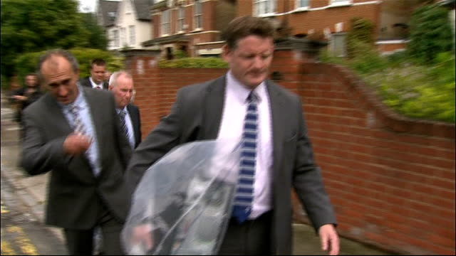 andy coulson arrested england south london forrest hill photography ** police detectives leaving andy coulson's house carrying bags of evidence and... - andy coulson stock videos & royalty-free footage