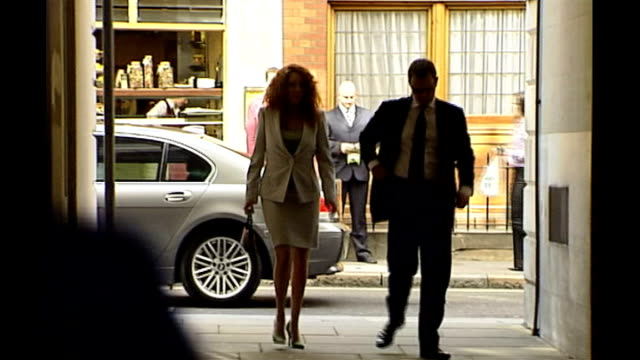 andy coulson arrested ext andy coulson and rebekah brooks along together and past press photographers as arriving at unidentified event - レベッカ ブルックス点の映像素材/bロール