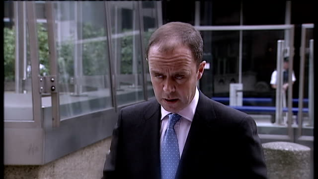 john yates resigns / sean hoare found dead lib new scotland yard ext various of assistant commissioner john yates speaking to press assistant... - conference phone stock videos & royalty-free footage