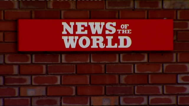 news of the world hacking scandal: royal british legion cuts its link with paper; wapping: news of the world sign at entrance to news international... - news of the world stock-videos und b-roll-filmmaterial