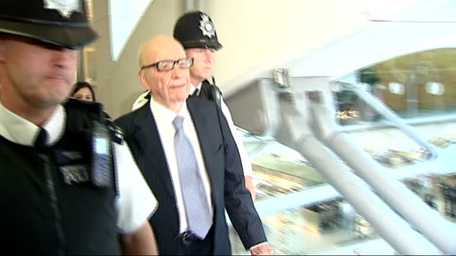 the murdochs and rebekah brooks give evidence to select committee house of commons portcullis house int rupert murdoch flanked by police along to... - レベッカ ブルックス点の映像素材/bロール