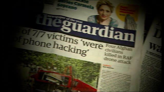 calls for inquiry and resignation of former editor england newspaper headlines on news of the world phone hacking scandal relating to milly dowler... - 新聞の見出し点の映像素材/bロール