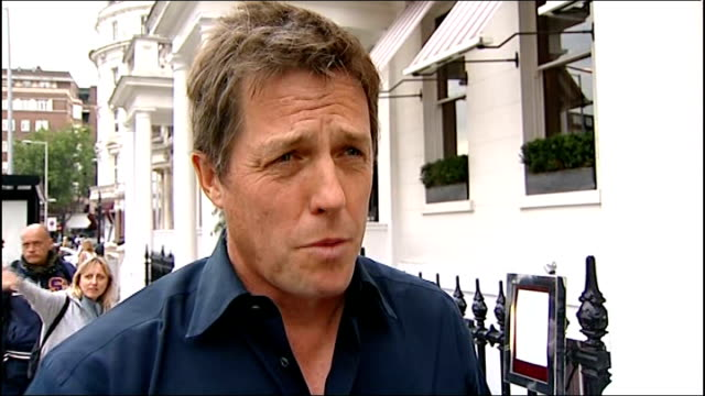 'news of the world' phone hacking scandal grows england london ext hugh grant interview sot - 盗聴点の映像素材/bロール