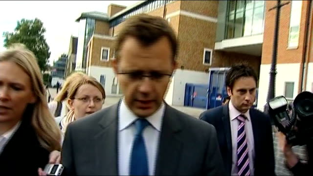 latest developments 872011 london photography ** various shots andy coulson surrounded by press/media scrum as departs police station ends - 盗聴点の映像素材/bロール
