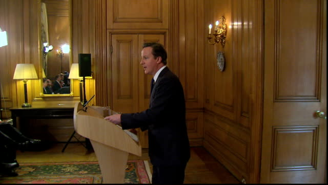 latest developments LIB INT David Cameron MP along to podium for press conference General views Cameron speaking