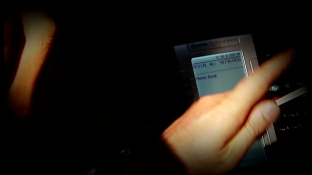 New claims that hacking continues SLOW MOTION RECONSTRUCTION Hands pressing mobile phone keypad
