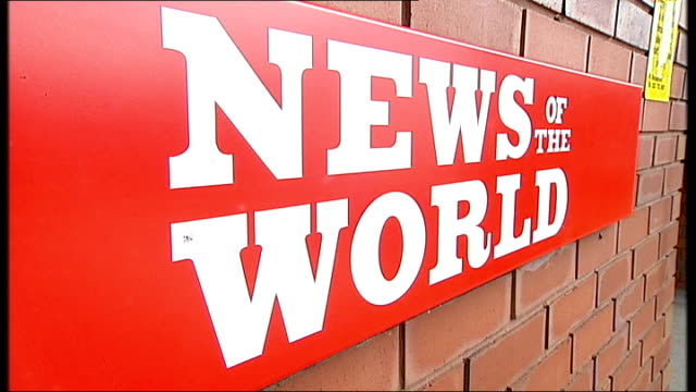 news of the world phone hacking scandal: news of the world paper to close; close shot of 'news of the world' sign at entrance to news international... - news of the world stock-videos und b-roll-filmmaterial